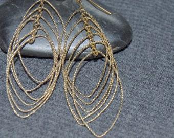gold multi loop earrings, long gold teardrop earrings, large rotating oval earrings, rotating hoops, dangle oval hoops, dangle hoop earrings