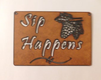 Sip Happens wine sign made out of rusted metal