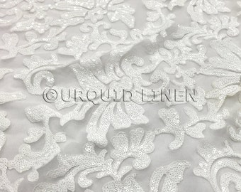 Milan Lace Fabric in White - Luxurious Lace Fabric w/ Sequins Embroidery Throughout - Great For Weddings, Bridal Parties, and Special Events