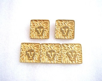 ANNE KLEIN - Set of gilded brooch and pierced earrings with Anne Klein lion logo