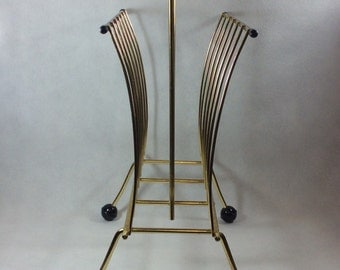 Vintage magazine rack mid century atomic space age newspapers gold metal George Nelson style ball feet