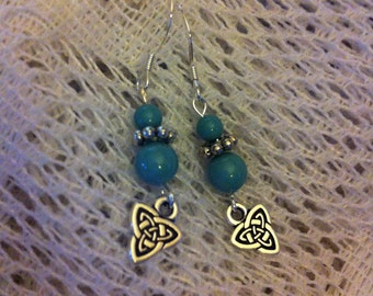 Green jade pearl and silver pierced earrings with triad Celtic knot charms.