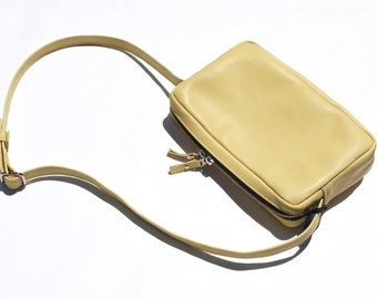 Yellow trapeze shoulder bag