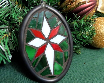 Handmade Christmas star suncatcher / ornament (red and green)