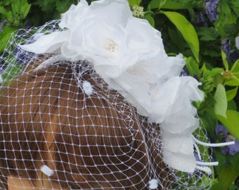White  brides  merry widow  spot  veiling  and flower.Wedding.