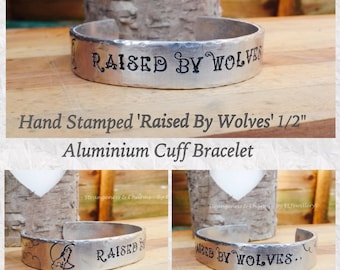 "Hand Stamped 'Raised By Wolves' 1/2"" Aluminium Cuff Bracelet, Howling Wolf, Wolf Jewellery, Wolf Moon, Metal Jewellery, Bracelet, Unique."
