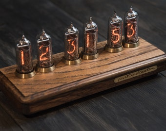 Nixie tube clock in oak and brass case