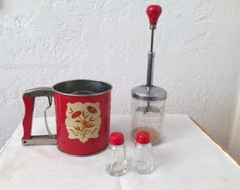 RED KITCHEN UTENSILS. Vintage 1950s Sifter, Hand Chopper and Salt & Pepper shakers. Nice for use or display!