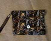 Camo Waterproof changing mat with storage pockets and stroller strap