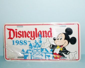 1988 Disneyland Souvenir License Plate Metal With Mickey Mouse and Cinderellas Castle Theme Park Souvenir