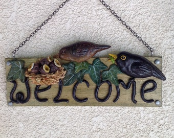 Blackbirds nest welcome sign