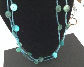 vintage long necklace showing Iridescent turquoise discs on a fine silvered chain