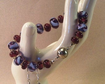 handmade flamework glass bead bracelet and earring set.