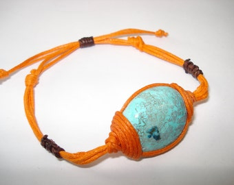 Amazing  blue color of chrysocolla crystal bracelet it comes with an orange cord.