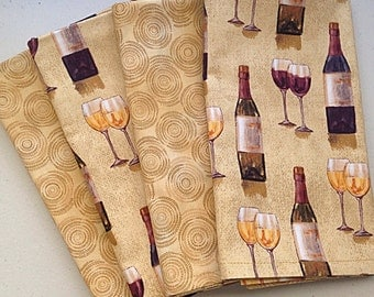 Wine theme double-sided  LAP  19  by 17 cloth napkins, wine bottles, glasses on a beige toned back ground.  Back is a beige  pattern.