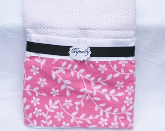 Pink floral flannel baby blanket with satin binding