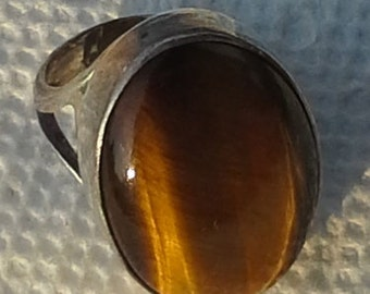 Handmade sterling silver, with oval cabochon tiger eye ring