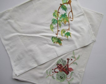 Two embroidered linen tea towels