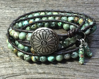 Three-wrap African Turquoise with brown leather and charms