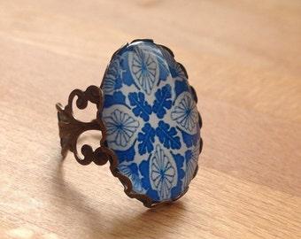 Antique brass blue filigree ring.