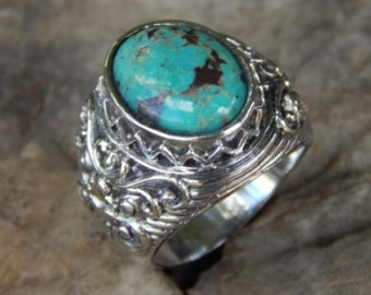 Silver ring Boma motif with turqoise stone
