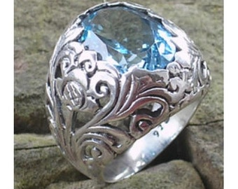 Silver ring bun flower motif with blue topaz stone