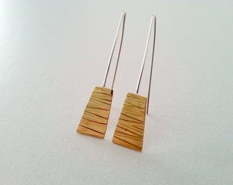 OUTLINE strokes in brass combined with steel and Silver II
