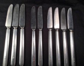 Set of 9 US Army Stainless Steel dinner knives from 3 different Makers marks.  Vintage Collection
