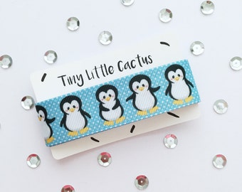 Penguin Ribbon, polyester, single-sided printed, 2, 5 cm wide