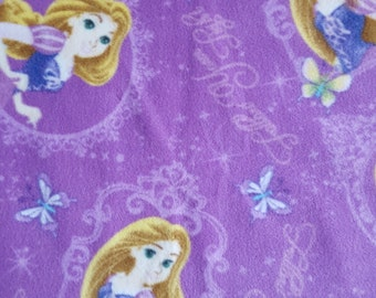Fabric by the 1/2 Yard - Disney's Tangled Rapunzel Fleece Fabric