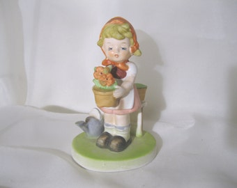 Flambro Figurine - Collectors Choice Series - Girl with Flowers