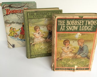 Three (3) Bobbsey Twins Books.  At Snow Lodge (1913), Keeping House (1925), Merry Days Indoors and Out (1950). Laura Lee Hope.