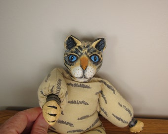 Vintage Indonesian tabby cat doll or figurine with painted wood head and paws, soft poseable body