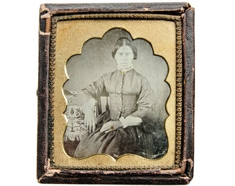 daguerreotype of a woman seated with a Jacquard coverlet