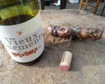 Old Cork Screw made from the wood of an old vine. Beautiful tactile Gnarled Appearance with Wine label Arbois Henri Maire