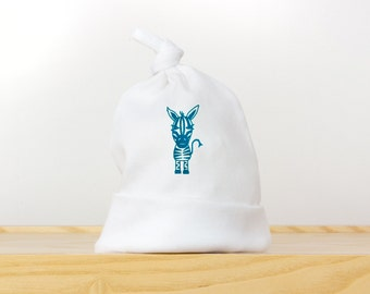 Newborn knotted hat with turquoise Zebra