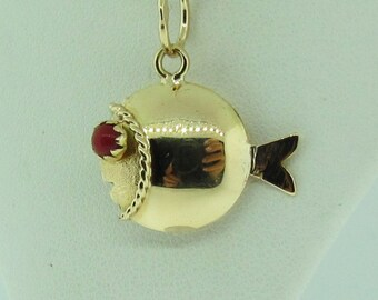 4-D fish charm. Vintage. Red eyes.