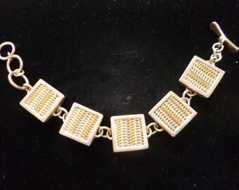 Sterling Silver ajustable bracelet woven in brass & copper.