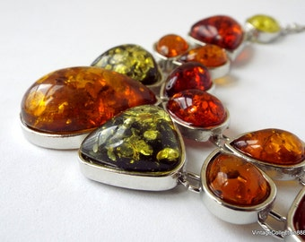 Amber Necklace with red, green, orange and yellow colors