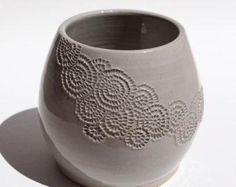 Short hand carved Vase