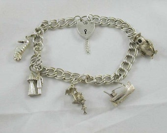 Sterling silver charm bracelet & five 5 charms  23.66 grams