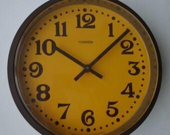 Vintage wall clock Hanson 1970s ochre yellow mustard brown made in Ireland mid century modern seventies