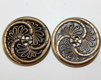 Two Vintage metal buttons with swirling leaf design