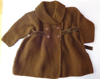 Girls hand knitted coat, size 26 inch chest approx 3+ years. Chocolate double breasted with 4 buttons an ribbon tie.