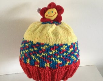Hand Knit Child's Hat with Smiley Flower