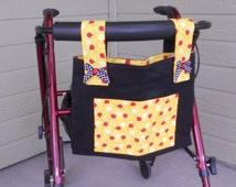 """Walker Bag. Bag for walker.  Ladybug themed walker tote bag.  Black denim, ladybug lining  Front pocket. Velcro closure. Size 15"""" W x 12"""" D."""
