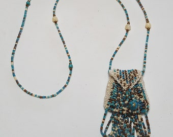 The Brigitte, a bead knit necklace purse amulet bag in browns and turquoise