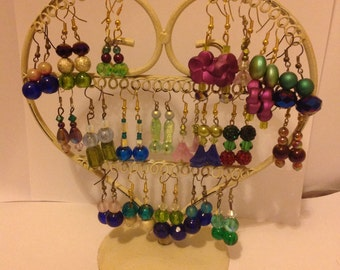 Selection of colourful fun  eyecatching earrings. Unusual necklaces
