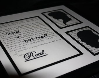 "Upcycled Hand-Painted ""Real or Not Real"" with Katniss and Peeta Silhouette The Hunger Games: Mockingjay Book Page Wall Art"