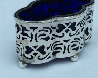 Silver salt with blue glass liner Height  3.5cm Length 7cm